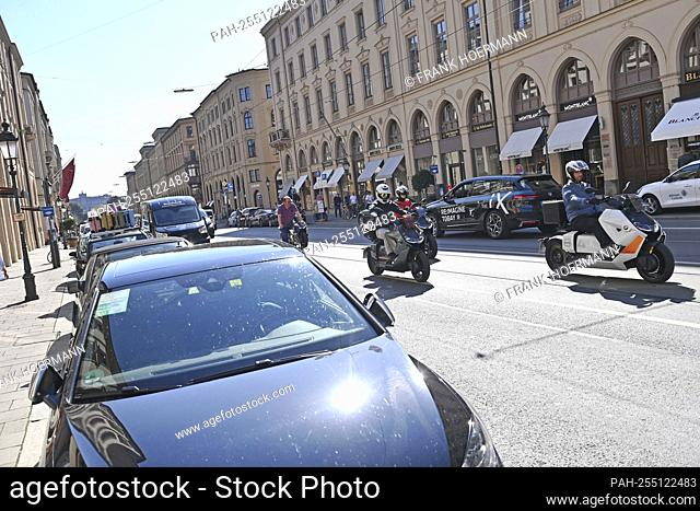 Heavy traffic in Maximilianstrasse, cars parked on the roadside, motorcycles are on the move. Open Space.IAA Mobility Fair from September 7th to September 12th