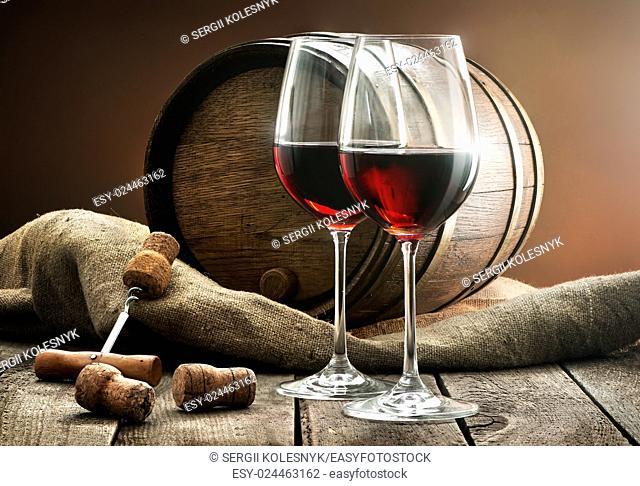 Composition with wine and cask on a wooden table