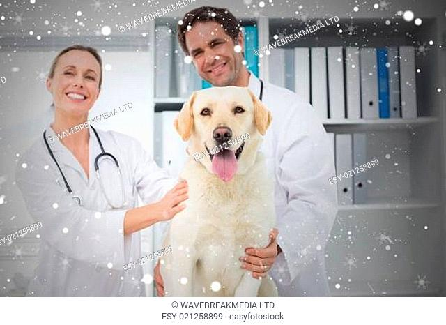 Composite image of happy veterinarians with dog