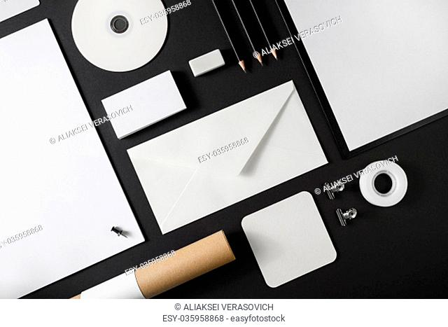 Photo of blank stationery set on black background. Corporate identity template. Branding mock up. Top view