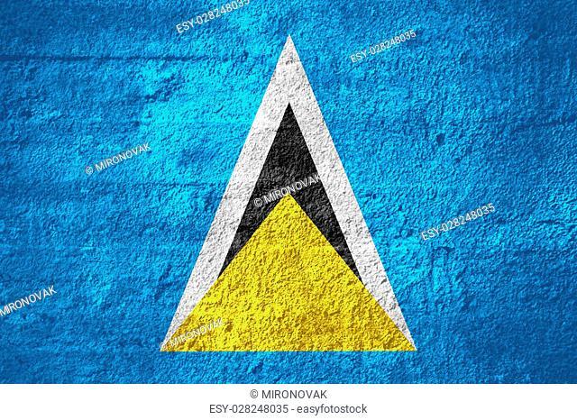 flag of Saint Lucia or Saint Lucian banner on rough texture