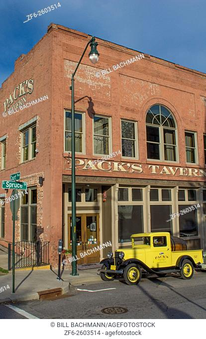 Asheville North Carolina Pack Square with yellow old historic truck at Pack's Tavern in vintage building