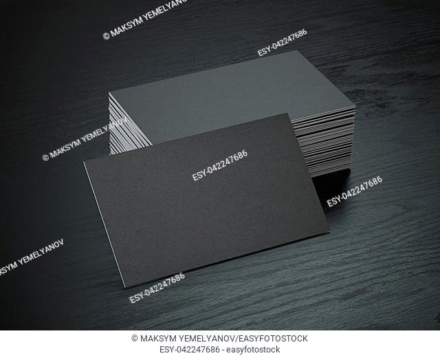 Stack of black blank business cards mockup on black wood table background, 3d illustration