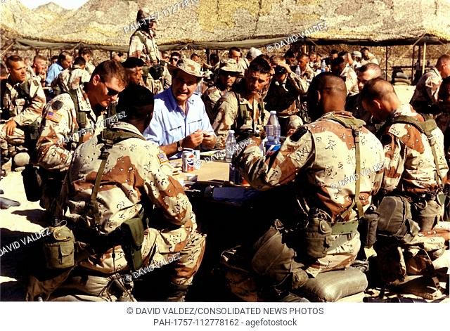 Saudi Arabia - November 22, 1990 -- United States President George H.W. Bush shares the holiday meal with United States military personnel in Saudi Arabia on...