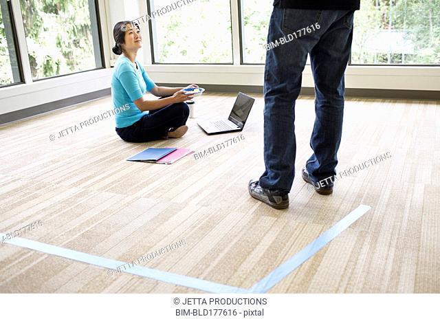 Business people talking in empty office