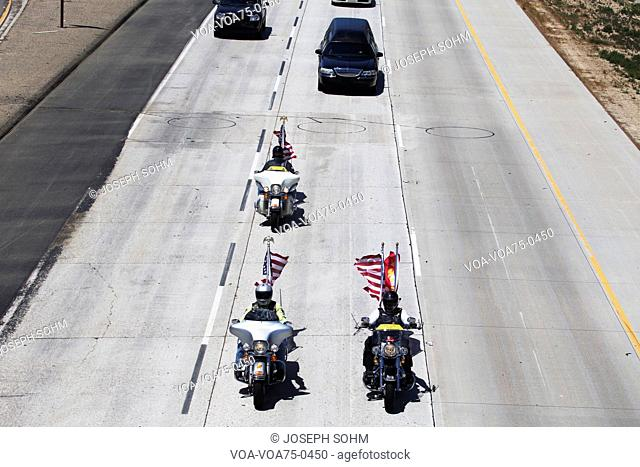 Patriot Guard Motorcyclists honoring fallen US Soldier, PFC Zach Suarez, Honor Mission on Highway 23, drive to Memorial Service, Westlake Village, California