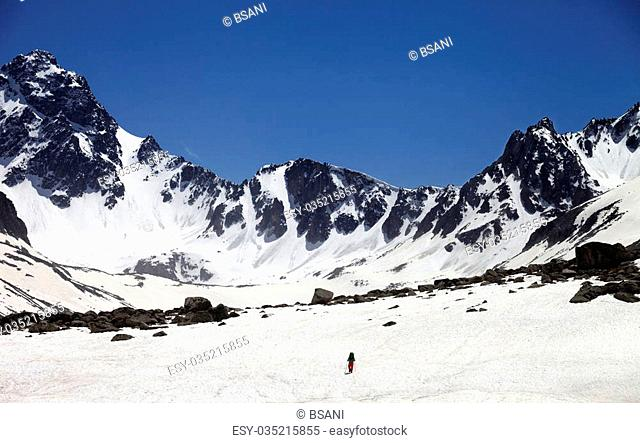 Hiker in snowy mountains. Turkey, Kachkar Mountains in spring (highest part of Pontic Mountains)