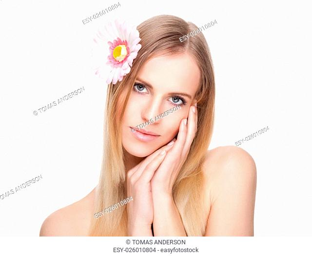 Beautiful young woman with a flower in her hair