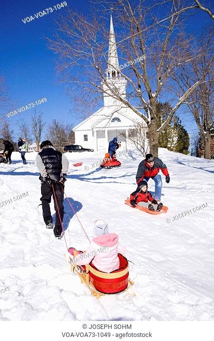 Sleigh riding in fresh snow in front of New England Church, in town of Harvard, Ma., New England, USA