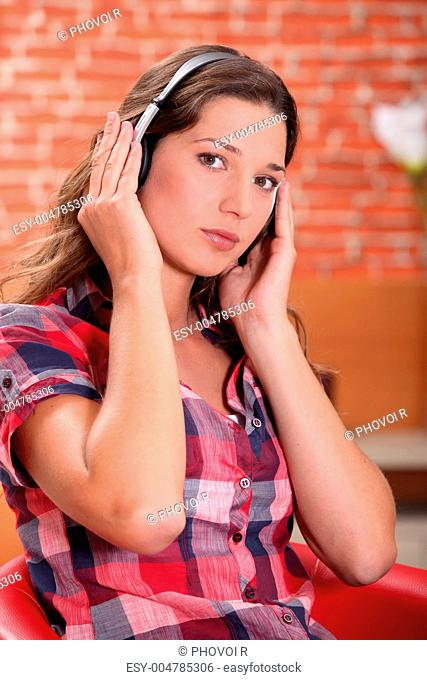 A woman listening to music