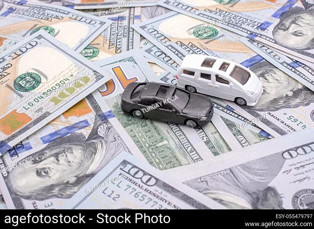 Model cars placed US dollar banknotes spread on ground