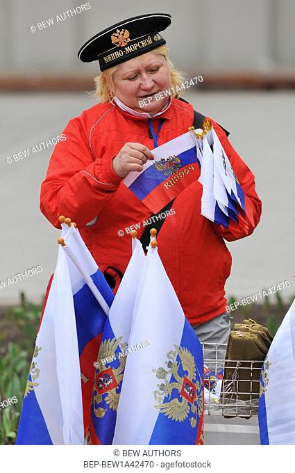 Russia, Moscow, Women with russian flags of the Russian Communist Party participate in the 1st of May Day parade in Moscow