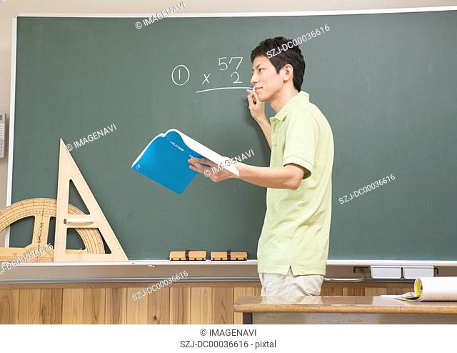Teacher giving a math class