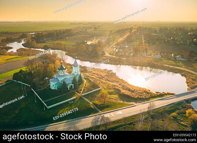 Krupets, Dobrush District, Gomel Region, Belarus. Aerial View Of Old Wooden Orthodox Church Of The Holy Trinity At Sunny Autumn Day
