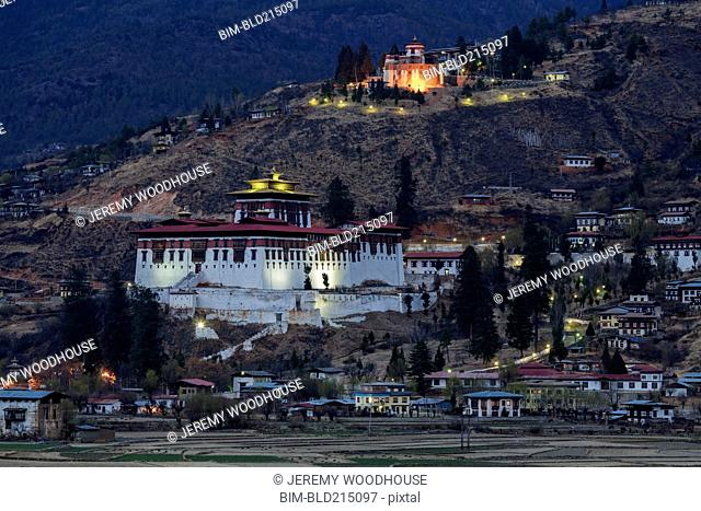 Illuminated buildings on remote hillside, Paro, Paro District, Bhutan