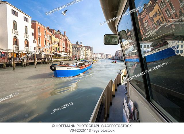 Trading boat and a Vaporetto on the Grand Canal (Canale Grande), Venice, Italy, Europe