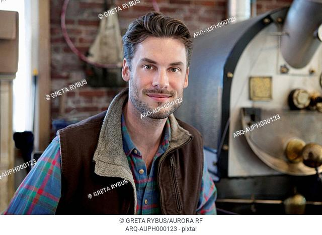 Man standing in front of coffee grinder