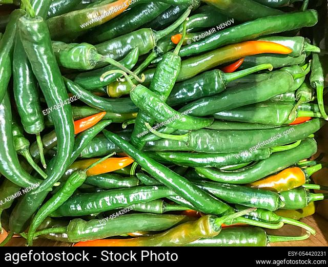 Raw green chili peppers. Healthy fresh food background