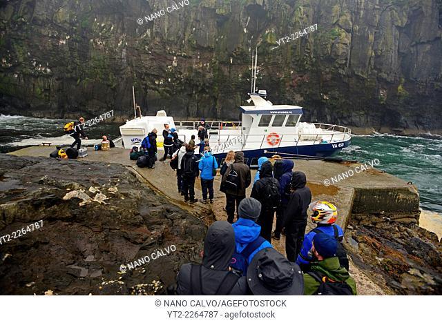 Visitors leaving Mykines island in ferry called Jósup, Faroe Islands