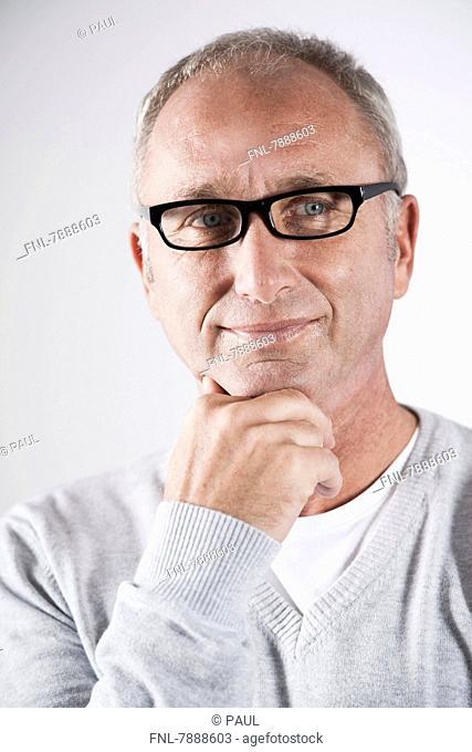 Headline: Smiling mature man wearing glasses