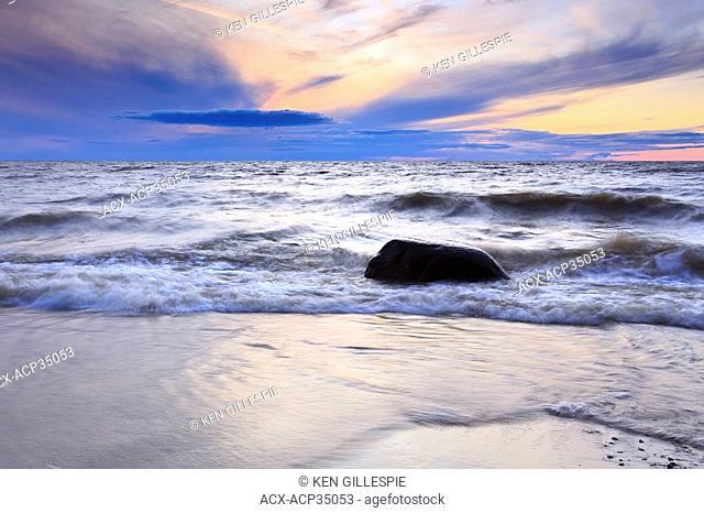 Waves on Lake Winnipeg at sunset. Lester Beach, Manitoba, Canada