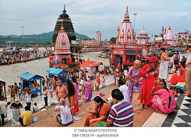 Pilgrims bathing and praying at Har Ki Pairi ghat in the Ganges River