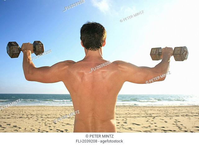 Man Working Out On A Beach