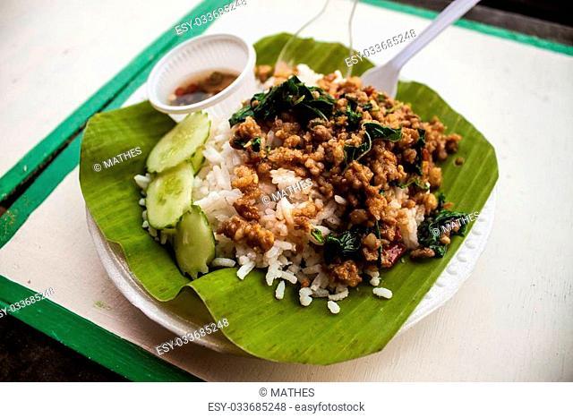 Thai rice meal on banana leaf at Ampahwa floating market in Samut Songkhram, Thailand