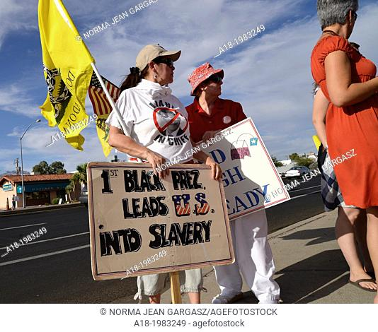 "Tucson Tea Party Coalition member, Rosa Cannoli, (left), along with about 30 others, protests what the coalition says is """"the unholy alliance of Barack H"
