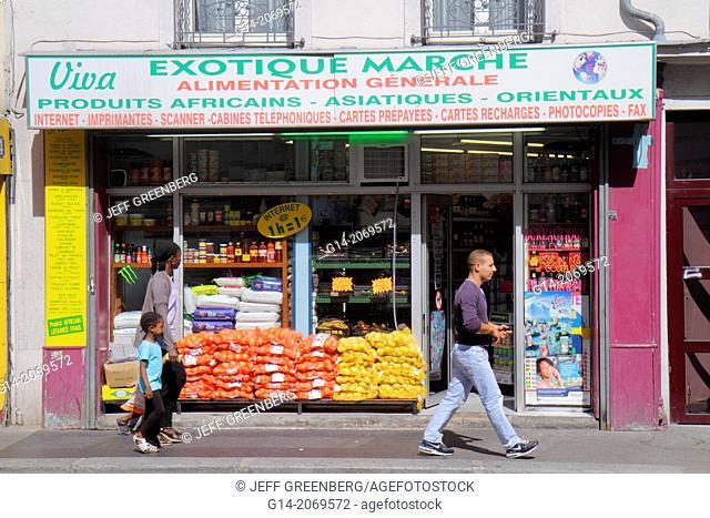 France, Europe, French, Paris, 18th arrondissement, Avenue de la Porte de Montmartre, market, grocery store, imported producs, food, pedestrians, Black, woman