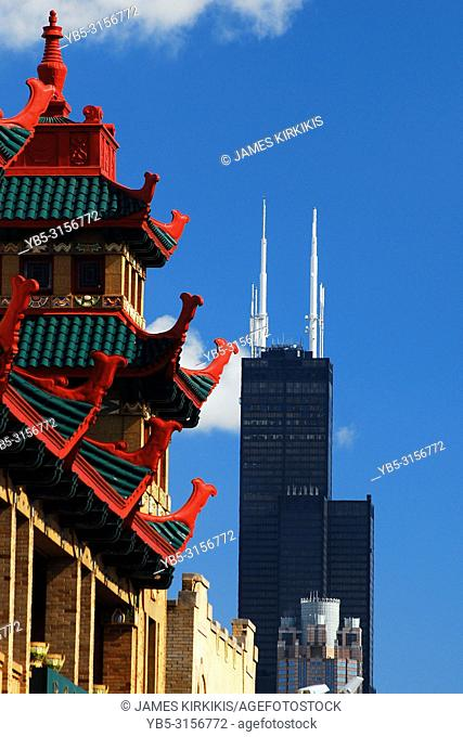 The Asian inspired buildings of Chicago's Chinatown shares the sky with the Willis Tower