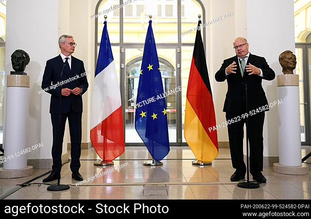 22 June 2020, Berlin: The French Minister of Economy and Finance Bruno Le Maire (l) and the German Minister of Economics Peter Altmaier (CDU) make a statement...
