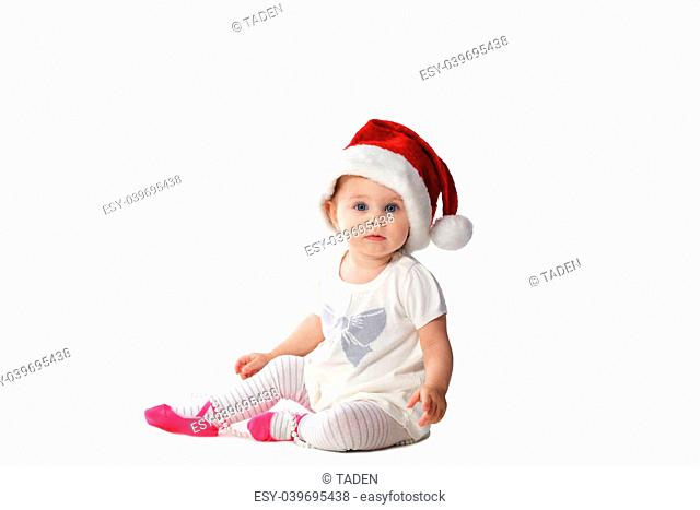 adorable baby girl in Santa hat with pearl necklace