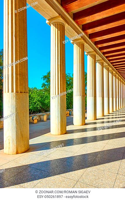 Perspective of colonnade of marble classical columns, Athens, Greece