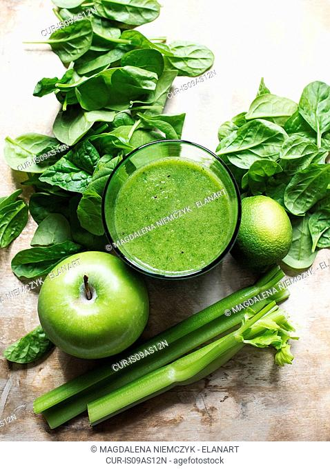Glass of fresh green smoothies with fruit and vegetables