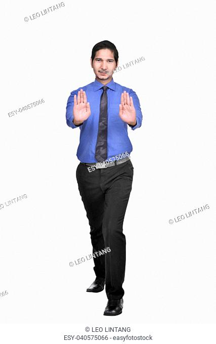 Handsome asian businessman pushing something isolated over white background