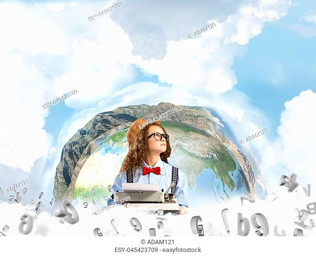 Portrait of thoughtful woman writer looking away and using typing machine while sitting at the table with flying letters and panoramic Earth globe among cloudy...