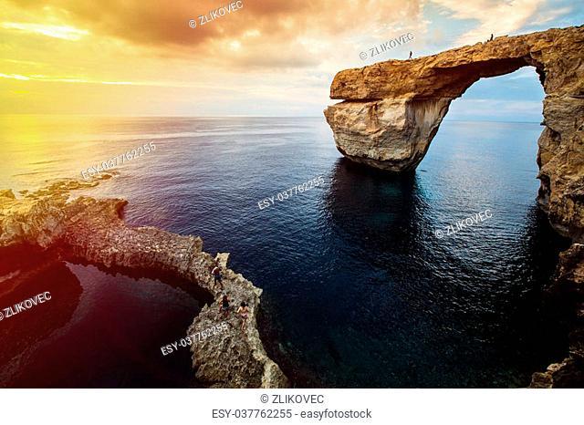 Azure Window, natural arch, famous landmark and popular tourist spot, on Gozo island, Malta, Mediterranean, at dramatic sunset
