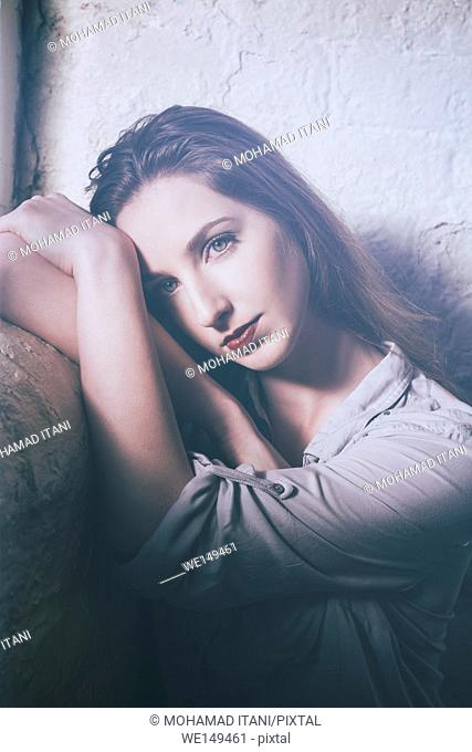 Beautiful young woman leaning on her arms