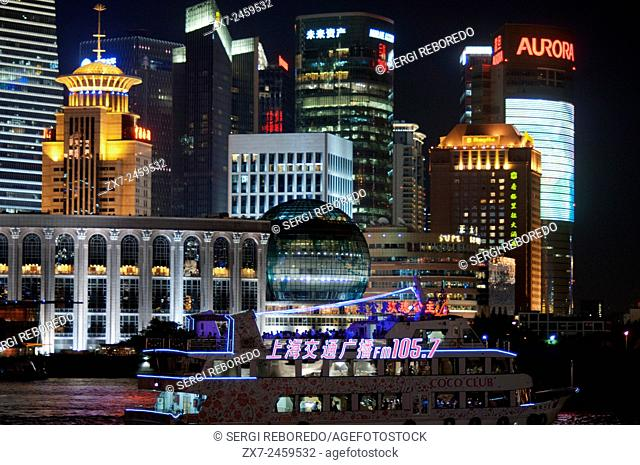 Pudong Skyline, by night, Shanghai, China. Skyline of Pudong as seen from the Bund, with landmark Oriental Pearl tower and Jin Mao tower, Shanghai, China