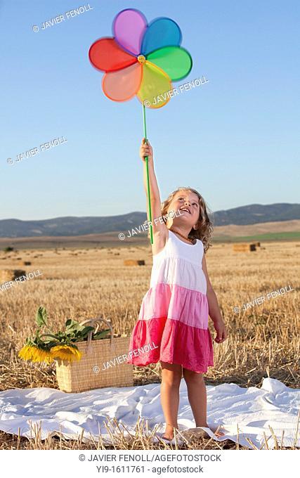 girl with pinwheel