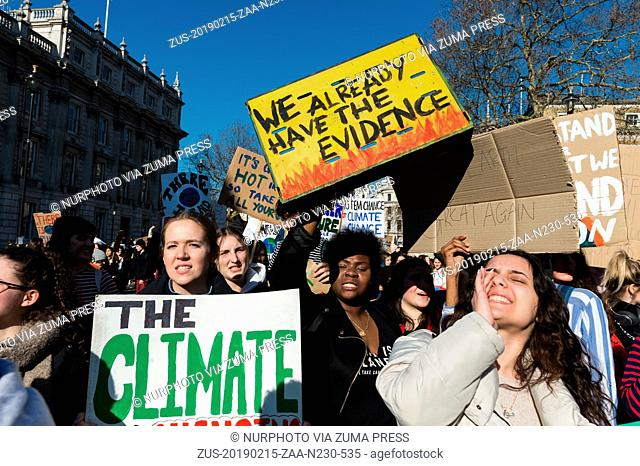 February 15, 2019 - London, England, United Kingdom - Thousands of young people gather in central London to protest against the government's lack of action on...