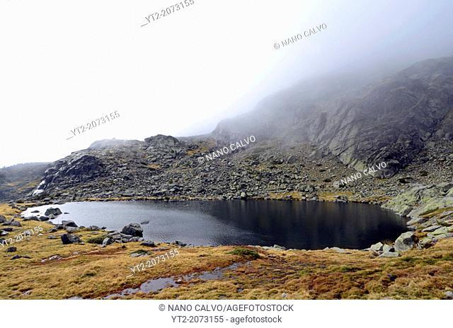 Foggy day in Peñalara, highest mountain peak in the mountain range of Guadarrama, Spain