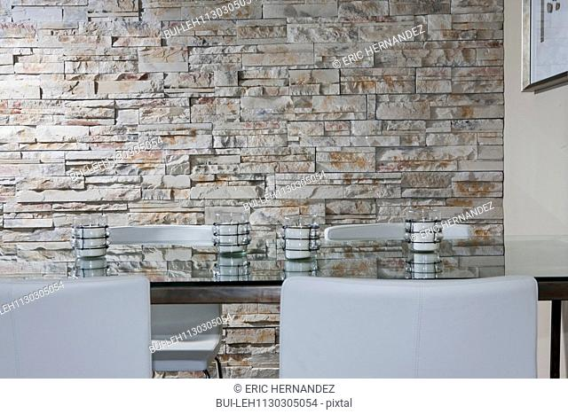 Dining table against stone wall
