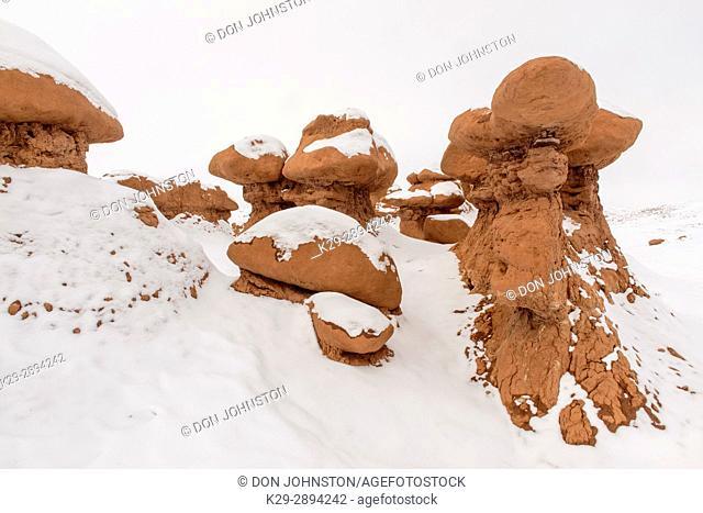 Fresh snow on the hoodoos in Goblin Valley, Goblin Valley State Park, Utah, USA