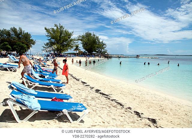 Tourists enjoying the beach on Coco Cay, are approximately 55 miles north of Nassau in the Bahamas