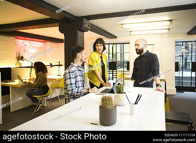 group discussing project in co-working space over coffee