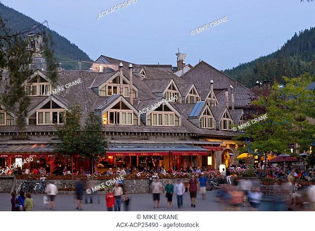 The clock tower of Whistler Villages Brewhouse Pub and Restaurant with blackcomb mountain in the Background. Whistler village is full of unique shops