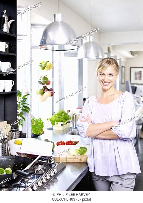 Woman in kitchen cooking food