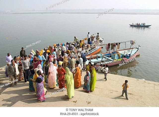 Women mourners take to a boat on the River Ganges while a cremation takes place, Varanasi, Uttar Pradesh state, India, Asia